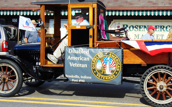 Debbie Blank | The Herald-Tribune<br /> An old-fashioned vehicle represented Brookville's Disabled American Veterans Post 90.