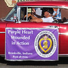 Debbie Blank | The Herald-Tribune<br /> A procession of classic cars carried a Purple Heart recipient, Disabled American Veteran and a handful of World War II veterans.