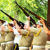 "Debbie Blank | The Herald-Tribune<br /> Batesville's veterans' firing squad presented the traditional ""Salute to the Dead"" just outside the Liberty Park Pavilion."