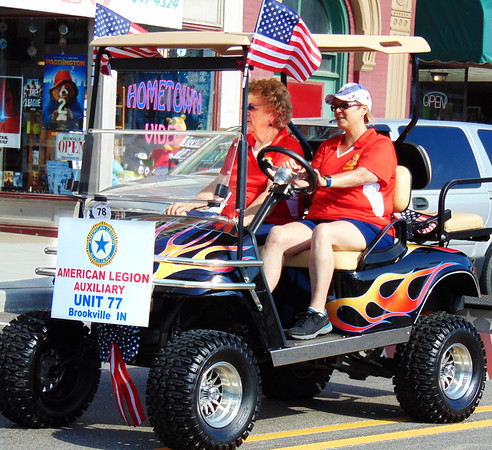 Debbie Blank | The Herald-Tribune<br /> Many types of vehicles, this one driven by an American Legion Auxiliary member, were in the procession.