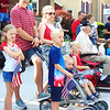 Debbie Blank | The Herald-Tribune<br /> One family not only dressed in red, white and blue, but also waved flags at procession participants.