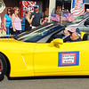 Debbie Blank | The Herald-Tribune<br /> Pastor Curtis Bond is driven along the parade route in a headturning car.