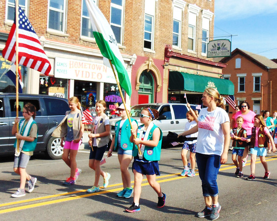 Debbie Blank | The Herald-Tribune<br /> Girl Scouts and Brownies were part of the solemn holiday.