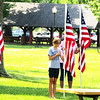 "Debbie Blank | The Herald-Tribune<br /> Indiana Patriot Guard Southeast Region members and relatives held flags when ""Taps"" was played."