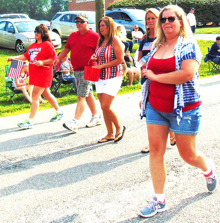 Debbie Blank | The Herald-Tribune<br /> Many wore red, white and blue during three days of Milan celebrations. Other activities were a 5K, fireworks, ice cream social, breakfast, chicken lunch and steak dinner.