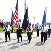 Debbie Blank | The Herald-Tribune  <br /> Milan American Legion Post 235 members were met with applause when they carried flags on Mill Road east of North Main Street to start the Milan Lions Club Fourth of July Parade at 10 a.m.