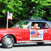 "Debbie Blank | The Herald-Tribune<br /> An elderly man driving a Mustang wrote his sentiment on a sign: ""Old Glory -- Long May She Wave."""