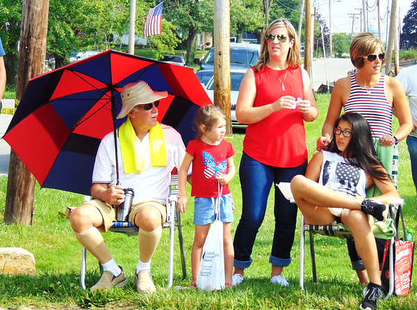 Debbie Blank | The Herald-Tribune<br /> John Pieper (from left), Milan, watches the parade with granddaughter Sophie Andrew, 4, her mom Mandy Pieper-Andrew, Milan, her sister Megan Schaefer, Batesville, and Megan's daughter Sydnee (sitting), 13.