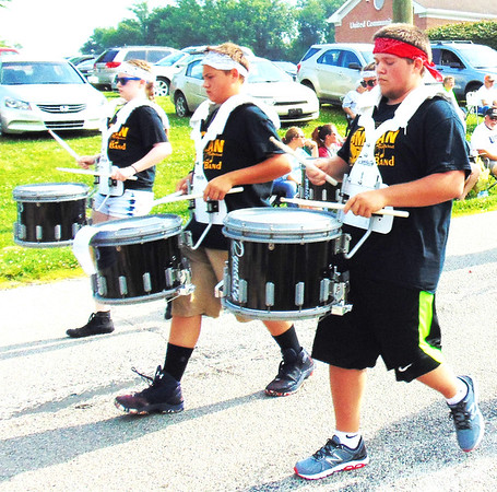 Debbie Blank | The Herald-Tribune<br /> Milan High School Marching Band students brought music to the procession.