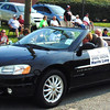 Debbie Blank | The Herald-Tribune<br /> Parade Grand Marshal the Rev. Harris Long got a lot of love along the route.