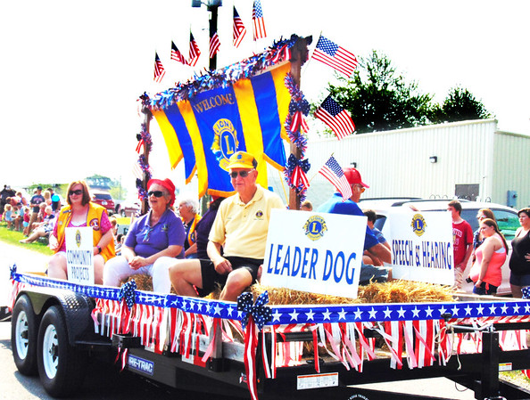 Debbie Blank   The Herald-Tribune<br /> Milan Lions, who organized the procession, educate bystanders about their volunteerism.