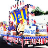 Debbie Blank | The Herald-Tribune<br /> Milan Lions, who organized the procession, educate bystanders about their volunteerism.