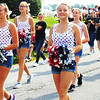 Debbie Blank | The Herald-Tribune<br /> Exuberant students with pompoms led the high school marching band through the streets.