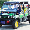 Debbie Blank | The Herald-Tribune<br /> A man in military attire drove a John Deere vehicle in the procession.
