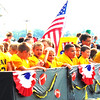 Debbie Blank | The Herald-Tribune<br /> Young Milan football players look for friendly faces in the big crowd.