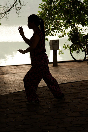 Before the heat comes people do exercises including Tai Chi.