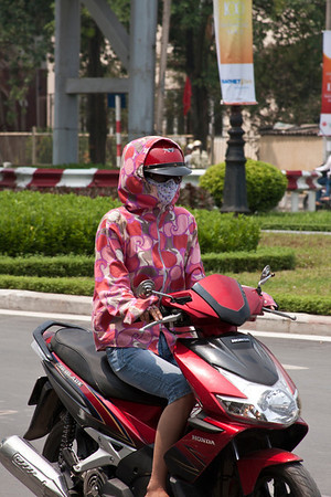 Masks are worn because of pollution. You don't feel it very bad on the sidewalks but in the middle of other motorbikes it's a different situation.
