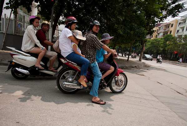 Whole family on a motorbike. Cars have huge duty taxes and most people can't afford them. After seeing the traffic level I don't want to imagine what would be to have a similar number of cars on the streets.