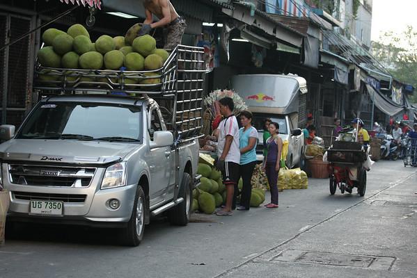 People unloading jackfruits.