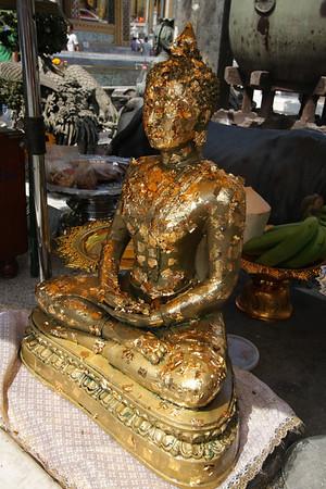 Buddha statue in golden leaf.