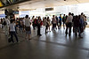 People waiting for the Skytrain in Bangkok. Each door has a waiting spot marked on the ground.