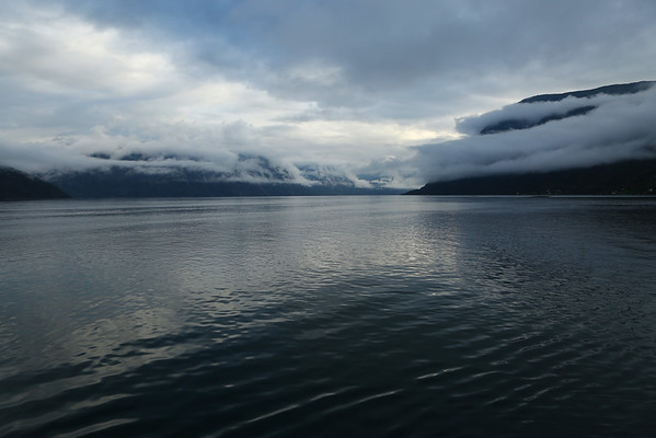 Fjord crossing in the morning when clouds are still low.