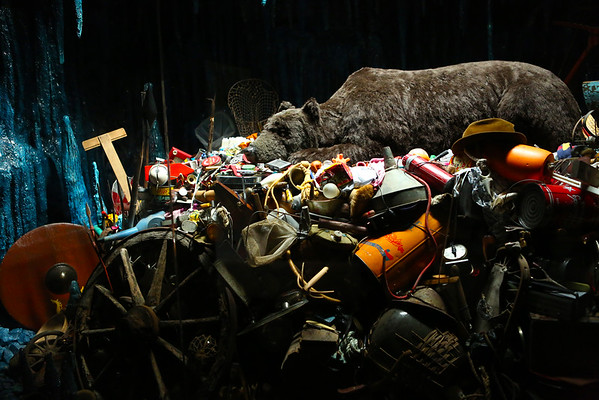 Bear sleeping in an artificial cave on a pile of items that shouldn't be found on mountains. All places had no rubbish so maybe the message worked.