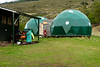 If you are looking for something more comfortable there is the option to sleep in a bed. They are dormitory style and you'll need to bring your own sleeping bag. At this camping site they were provided inside the green spheres.