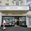 October 2013. Morecambe, Lancashire. In a parade of dilapidated promenade shops is another beacon (or cone) of hope hanging on from the 1930s. This is Brucciani's ice-cream parlour, established in 1939 and now a Grade II listed building.
