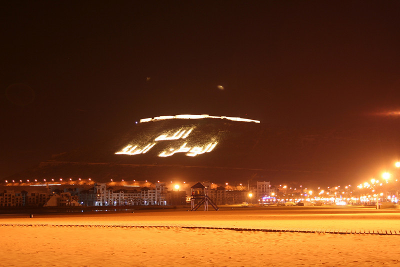 The hill with the Arabic script looking over the beach in Agadir.
