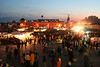 The sun setting and the Place Djemma El-Fna' getting busy on a Sunday night in Marrakech.