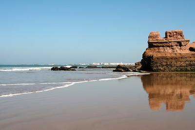 The beach in Morocco with Essaouira in the background.