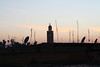Over the rooftops (and many satellite dishes) to the Koutoubia Mosque as the sun sets.
