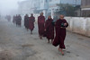 The monks don't have any income. Every morning they roam the streets with their alm bowls and people donate food.