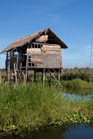 Traditional house raised above the lake. It's their way of protecting from water that raises during rainy season.