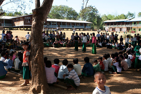 School in the village near the stupas. Foreigners are always the main attraction in this places and a good reason for break. They were practicing dancing.