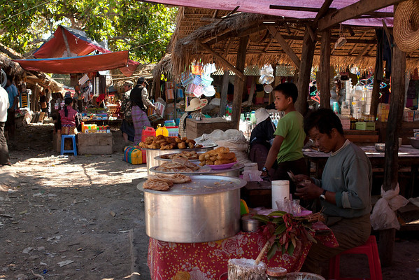 Local market where very few tourists come every day. This place is on the other side of the lake from Nyaung Shwe.