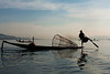 One leg rowing, the only place in the world where it's used. No hand is involved when rowing, just one leg. This way the fishermen can have the hands free to work with the nets.