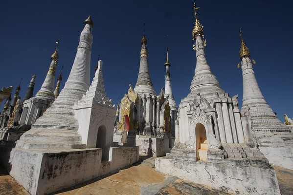 These stupas are on a hill, visible from the river. We asked the boatmen to take us there.