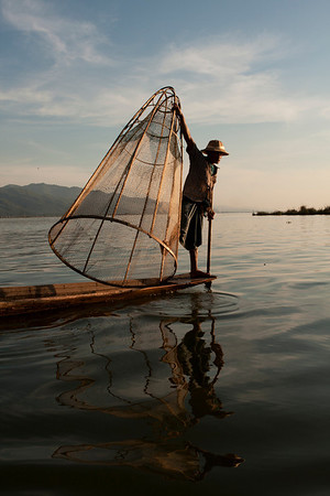 The picture everyone will have after a visit to Inle Lake. Of course, it's not due to the skills of the photographer but the skills of the actor. Some of them decided it's a lot easier to make money posing for tourists.