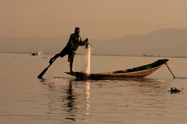 Traditional fisherman doing real work instead of looking for tourist boats as a source of income.