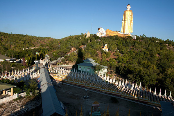 View from top of the golden stupa. All around there are small statues of Buddha and 2 huge ones on top of the hill.