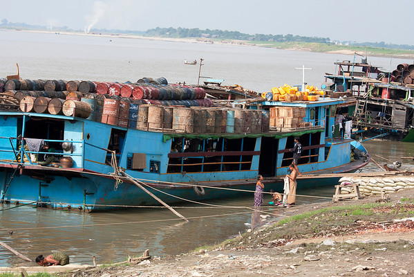 Overloaded boats. The Irrawaddy River river crosses the country from north to south and it's the most important commercial water route.
