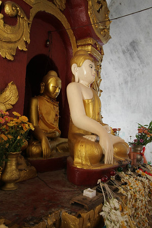 Due to some events the Buddha in the back did not want to look anymore at the people. When he started to look down they built another one in front of him.