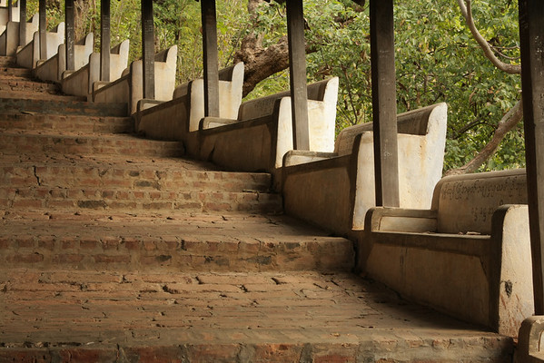 Going up on a hill in Sagain. The names on benches are the names of people who donated money to raise the temples.