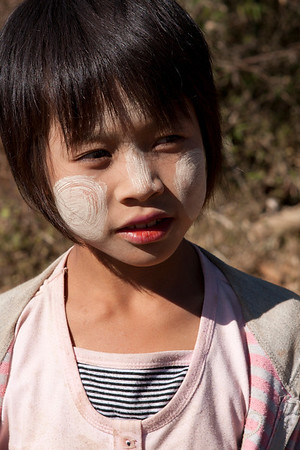 Traditional Thanaka makeup. The wood of several trees can be used to prepare the powder before being applied.