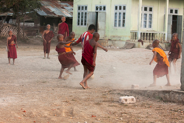 Apprentice monks playing football at the monastery.