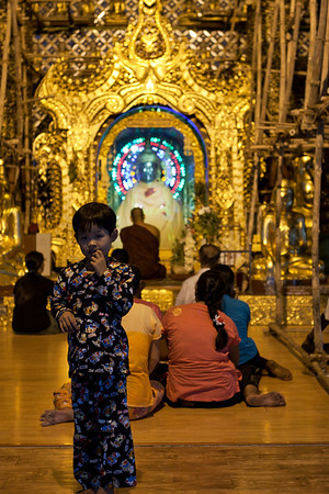 People praying in one of the small temples.