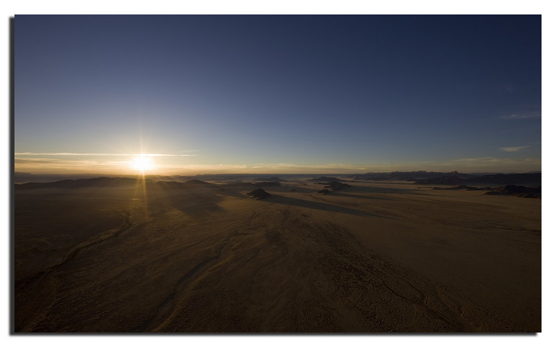 41. Beautiful sunrise over the mountains and the Namib desert.