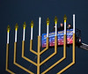 "National Menorah Lighting in Washington DC (2013) : A special lighting ceremony took place for the National Hanukkah Menorah, the world's largest, on the Ellipse, just across from the White House on the first night of the eight-day Jewish holiday. The Jewish calendar follows the course of the moon. This year, the first day of Chanukah fell on Thanksgiving, an event so rare it is not scheduled to happen again for thousands of years. Despite the holiday's occurrence in November, the weather was very Winter-like; cold, wet and windy.  The first candle on the National Menorah was lit on Wednesday, November 27, 2013 by special guest, U.S. Trade Representative Michael Froman. The United States Air Force Band, Award-winning violinist Miri Ben-Ari and ""The Three Cantors"" performed. The national menorah lighting dates to 1979 when Jimmy Carter was president. Hanukkah celebrates the Jewish Maccabees' military victory over Syrian oppression more than two-thousand years ago. A candle is lit each night of the eight-day celebration, commemorating the miracle of one day's supply of oil lasting a full eight days in the lamp following the re dedication of the Holy Temple in Jerusalem. Following the ceremony, those in attendance were treated to hot traditional Chanukah latkes (potato pancakes), donuts and cookies. Attendance was free, but tickets had to be reserved in advance. The annual event is sponsored by American Friends of Lubavitch (Chabad), represented by Rabbi Levi Shemtov and his father Rabbi Abraham Shemtov"